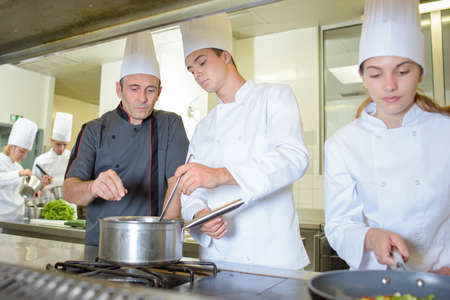 trainees: Chef working with trainees