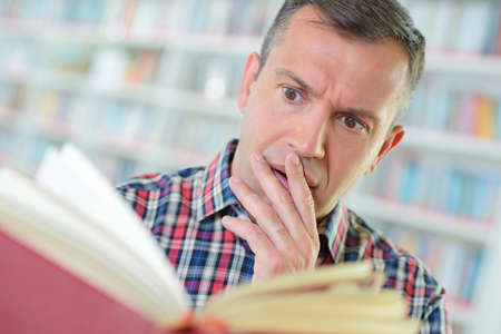 crazed: shocked reader Stock Photo