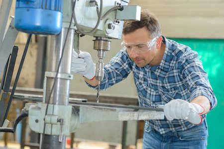 standard steel: man using a metal driller