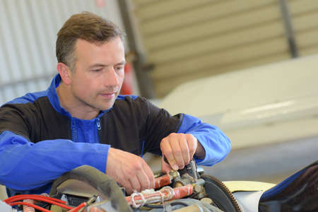 propulsion: Man working on aircraft Stock Photo