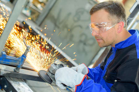 safety at work: metal polisher Stock Photo
