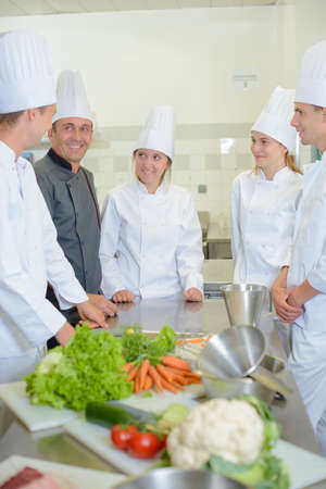 trainees: Trainees in kitchen with chef Stock Photo