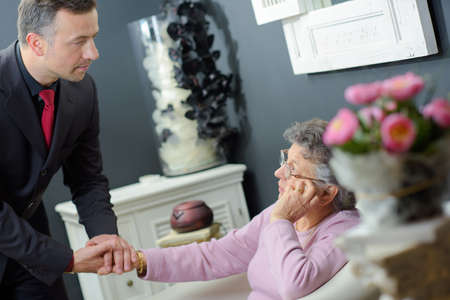 undertaker: Undertaker comforting elderly woman