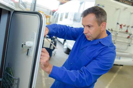 Mechanic working on camper van