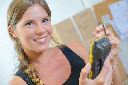 handheld device: woman using a hand-held inventory device
