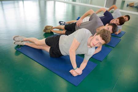 matt: men on their mats Stock Photo