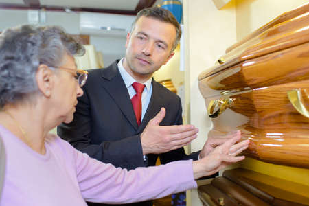 formalities: Undertaker showing a woman a coffin Stock Photo