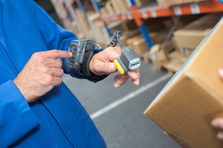 barcode scanner: Man using wearble barcode scanner Stock Photo