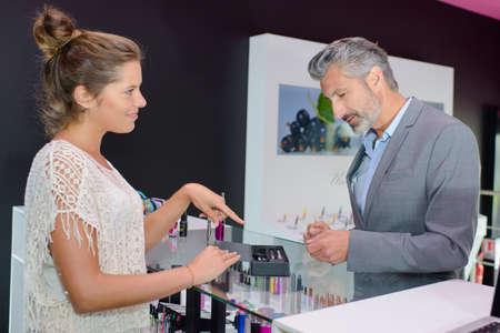 persuades: man choosing a flavor for e-ciggarettes