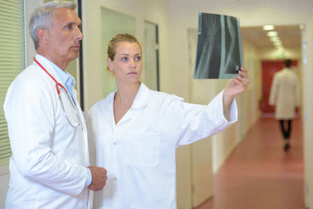 Two doctors looking at xray