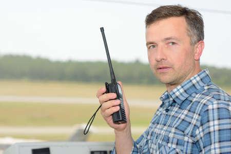 receiver: Man holding radio receiver Stock Photo