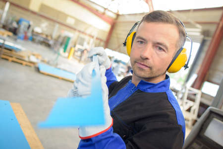 work worker: factory worker doing his work