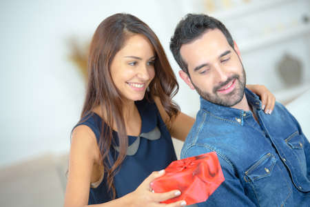 this: Woman giving a simple present to man