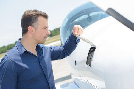 flap: Man lifting flap on aircraft