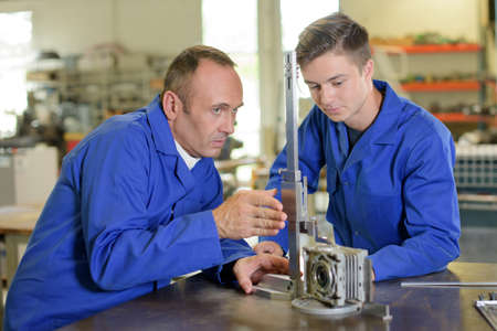 eye service: Technician and apprentice setting up equipment