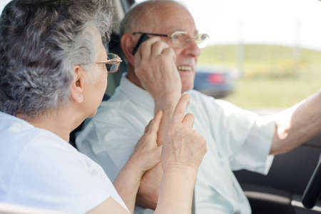 disobey: Male using cellphone while driving Stock Photo
