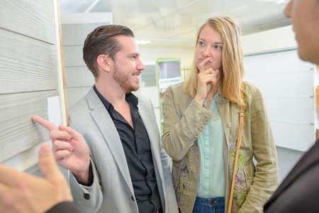 merchandiser: couple inside the showroom
