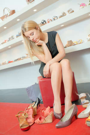 shoes woman: Simply cant decide on a pair Stock Photo