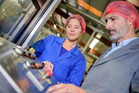guidance: food factory machine operator Stock Photo