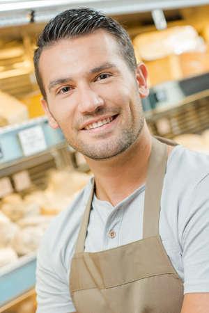 stood: Man stood in his bakery