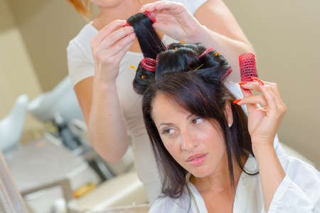 untangle: Woman with rollers in her hair Stock Photo