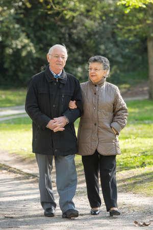 stroll: elderly couple on a stroll