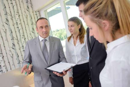duties: Man explaining duties to hotel staff
