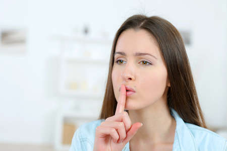 noiseless: Woman gesturing us to be quiet
