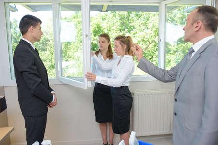 supervisor: Supervisor watching lady clean windows