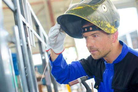 standard steel: welder checking his work