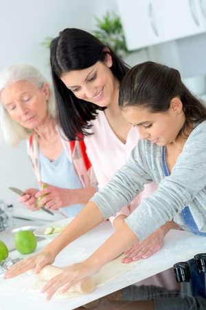 three generations of women: Three generations of women baking together