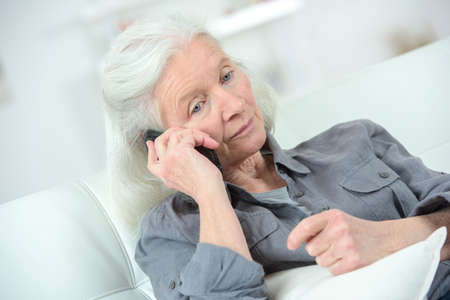 lady on phone: Senior woman on the phone