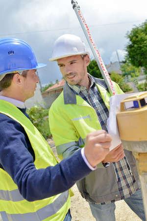 surveyors: Two site surveyors on a job