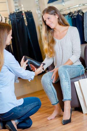 Sales assistant in a shoe shop