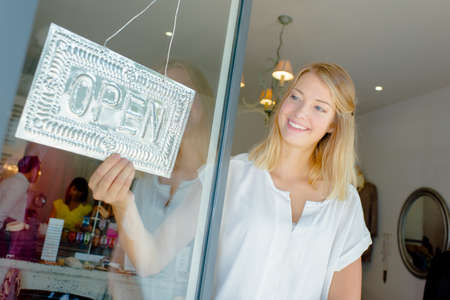open sign: Woman with open shop sign