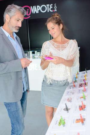 salesgirl: man in e-cigarette shop