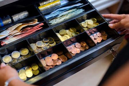 to till: Open cash till containing Euros
