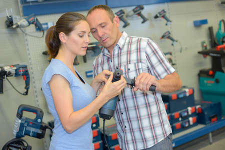 power tools: Man and woman looking at power tools