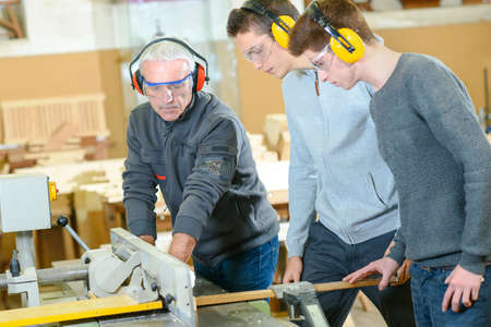 trades: Male students in a woodwork class