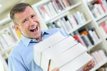 thesis: men with books Stock Photo