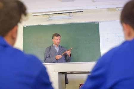 vocational high school: Teacher in front of blackboard Stock Photo