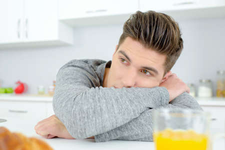 unmotivated: Bored man in the kitchen
