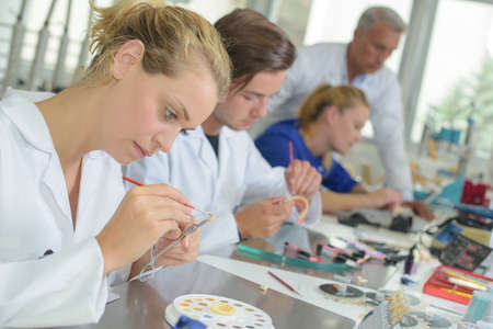 Woman working in dental laboratory Standard-Bild