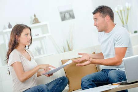spat: Couple arguing over bills