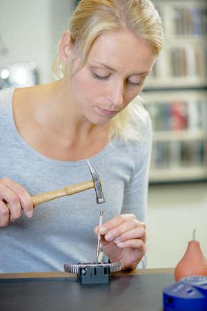 replacing: Woman replacing a watch strap