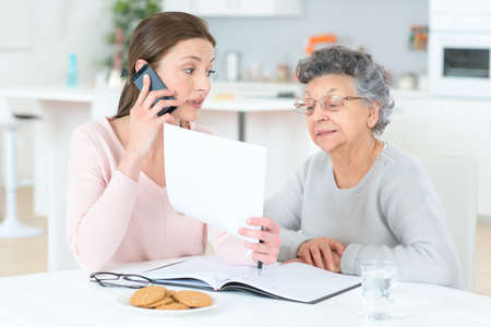 old carer: Helping senior lady with her finances