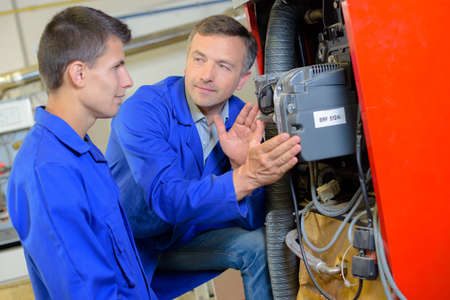 apprentice: Tutor showing apprentice the width of electrical box