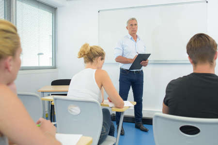 stood: Teacher stood before class