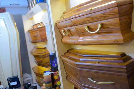coffins: Display of different styles of coffins Stock Photo
