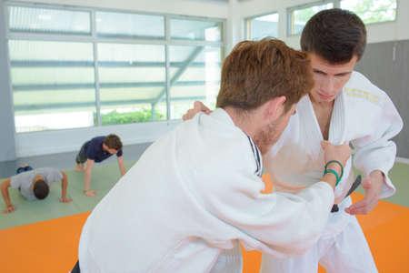 black grip: Two men in martial arts combat